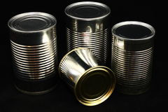 Unlabeled Cans On Black. Four unlabeled food cans photographed on a black background Stock Photo