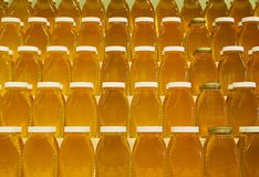 Jars of honey on shelves Royalty Free Stock Photography