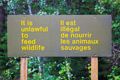 And it is unlawful to feed wildlife sign Stock Images