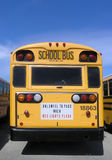Unlawful to Pass. Backside of a school bus parked in a bus lot Royalty Free Stock Images