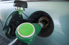 Unleaded. Car is filling of Unleaded fuel Royalty Free Stock Image