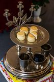 Unleavened bread on a silver tray with candle holder-triceram. The Eucharist — liturgical bread used in the Orthodox Church for the sacrament royalty free stock photos
