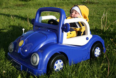 Unlicensed Driver. Child Driving Toy Car - Concept of Eager Learning stock images