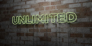 UNLIMITED - Glowing Neon Sign on stonework wall - 3D rendered royalty free stock illustration Stock Photography