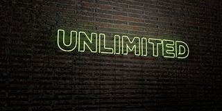 UNLIMITED -Realistic Neon Sign on Brick Wall background - 3D rendered royalty free stock image. Can be used for online banner ads and direct mailers Stock Images