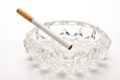 Unlit cigarette in glass ashtray Royalty Free Stock Photos
