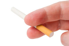Unlit cigarette in his fingers man's hand Stock Photography