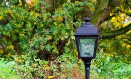 Unlit modern lamppost a decorative classical garden lantern for in the backyard royalty free stock photos