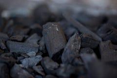 Unlit wood kol Arkivfoto