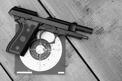 Unloaded air gun on target. Upon wooden table royalty free stock photography