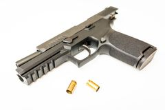Unloaded handgun with ammo rounds white background. Unloaded handgun with ammo rounds on isolated background Royalty Free Stock Photo