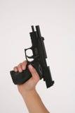 Unloaded Pistol. An unloaded pistol held aloft isolated on white background stock photos