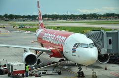 Unloading of baggage from the Air Asia aircraft Royalty Free Stock Photography