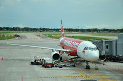 Unloading of baggage from the Air Asia aircraft Royalty Free Stock Photos
