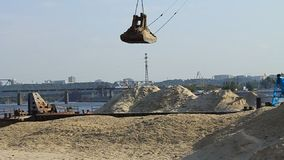 Unloading of barge. Unloading sand in river port stock footage
