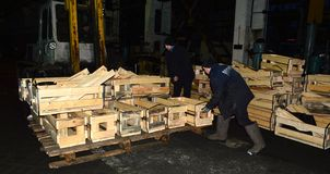 Unloading boxes for packaging finished products. Image of workers unloading crates Royalty Free Stock Photos