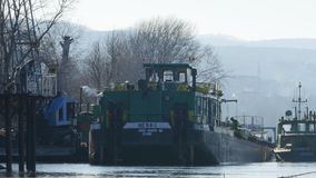 Unloading cargo ship, full crane bucket. Unloading cargo ship, full crane bucket, near Novi Sad, Serbia stock footage