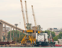 Unloading of cargo ship in the port of Burgas in Bulgaria Stock Photos