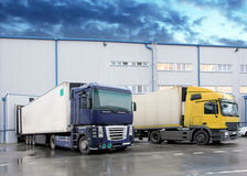 Unloading cargo truck at warehouse building Stock Photos