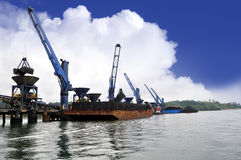 Unloading coal from barge to hopper at the coal port Stock Photography