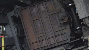 Unloading coal from a wagon. The car rolls up wheels. HD stock video footage