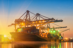 Unloading container of cargo ship terminal Royalty Free Stock Photography