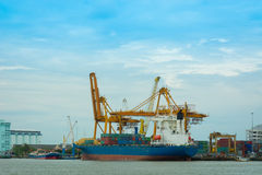 Unloading container cargo ship. Royalty Free Stock Image