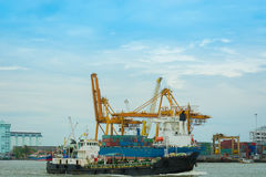 Unloading container cargo ship. Stock Image