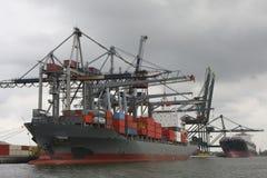 Unloading a container ship Stock Photos