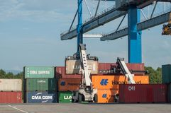 Unloading containers in port in border Rhine Royalty Free Stock Photo