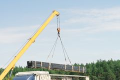 Unloading with a crane. Truck unload. Photo against the sky.  stock images