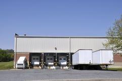 Unloading docks and trucks royalty free stock photos