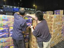 Unloading Fruit at a Wholesale Fruit Market. HONG KONG - JULY 2013: Workers at a wholesale fruit market unload fruit. The Wholesale Fruit Market in Hong Kong is Royalty Free Stock Photos