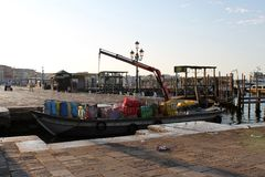 Unloading of goods from a boat in Venice Italy in the early morning stock image