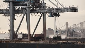 Unloading a huge ship stock video footage