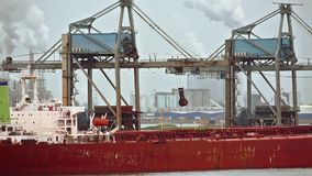 Unloading a huge ship. Unloading a huge bulk ore carrier ship stock footage