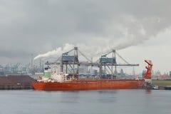 Unloading a huge ship Stock Images