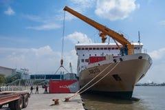 Unloading KM Kelud. BELAWAN, INDONESIA - MARCH 11: Dockworkers unload containers from the KM Kelud while docked in Belawan Medan, Indonesia, MARCH 2019 stock photo