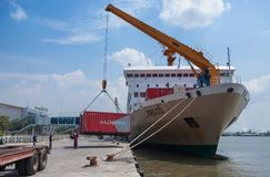 Unloading KM Kelud. BELAWAN, INDONESIA - MARCH 11: Dockworkers unload containers from the KM Kelud while docked in Belawan Medan, Indonesia, MARCH 2019 royalty free stock photo