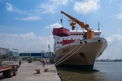 Unloading KM Kelud. BELAWAN, INDONESIA - MARCH 11: Dockworkers unload containers from the KM Kelud while docked in Belawan Medan, Indonesia, MARCH 2019 stock photography