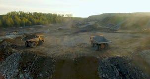 Unloading land from quarry dump trucks
