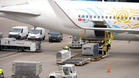 Unloading luggage containers from the aircraft stock video