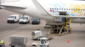 Unloading luggage containers from the aircraft stock footage