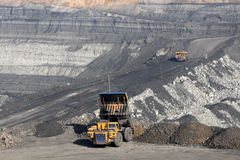 Unloading ore cars. Machines unload ore open pit Stock Images