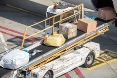 Unloading the packet from the fuselage of aircraft. royalty free stock images