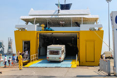 Unloading passengers and vehicles from ferry boat in seaport Royalty Free Stock Image
