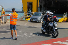 Unloading passengers and vehicles from ferry boat in seaport Royalty Free Stock Photography