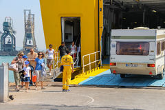 Unloading passengers and vehicles from ferry boat in seaport, It Stock Photography