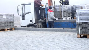 Unloading of paving slabs stock video footage