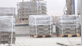 Unloading of paving slabs stock video